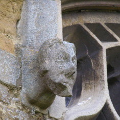 Carved face on Muston church