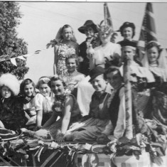 Close up of Bottesford Guide and Brownie Festival of Britain Float, 1951: Front row: Jean Dunsmore, Janet Tinkler, Margaret Fisher, Joy Baggaley, wearing garland - unknown, Anne Jallands, Jennie Norris, Margaret Carter (front right of pole). Middle row: Pat Barnes. At the back: Anne Dunsmore, Angela Bradshaw, holding a Dove of Peace, Mrs Lane
