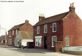 1970s view of the Post Office and Eric George's butchery