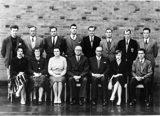 Belvoir Secondary School Staff 1960-61Back, left to right: Mr. Mike Brown, Mr. Martin, Mr. Macdonald, Mr. Bill Jeffs, Mr. Harry Carr, Mr. Fred Greenway, Mr. John Hodson, Mr. Dick Bradshaw. Front row: Ms. Ann Spencer, Ms. Maureen Brown, Mrs. Ogden, Mr. Dewey, Mr. Percy Stimpson, Ms. Dorothy Hodson, Mr. Pat Poyser.