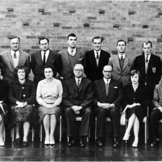 Back, left to right: Mr. Mike Brown, Mr. Martin, Mr. Macdonald, Mr. Bill Jeffs, Mr. Harry Carr, Mr. Fred Greenway, Mr. John Hodson, Mr. Dick Bradshaw. Front row: Ms. Ann Spencer, Ms. Maureen Brown, Mrs. Ogden, Mr. Dewey, Mr. Percy Stimpson, Ms. Dorothy Hodson, Mr. Pat Poyser.