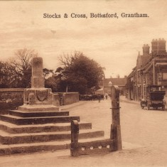 An old post card of the Cross, Stocks, Buick (or Studebaker) and hen.