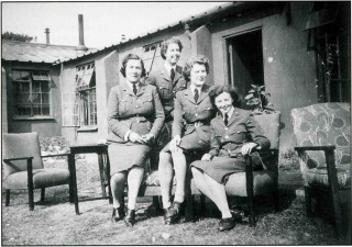 Outside the Bottesford WAAF Officers' Mess, 1942. Bunty Vardon (senior WAAF officer), Kay Kirby, Betty Davies and Lianne Beauchamp. Note the motley collection of furniture!