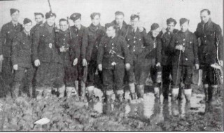 207 Squadron Armourers amid the appalling conditions at Bottesford during the winter of 1941. Left to right: Smithers, F /Sgt Weatherall, Eric, Bob Waldrer, Dennis Bentley, Bill Freeman, Ron Walker, 'Ginge', 'Housie', Alf, George, Eric King, Alan and Vic