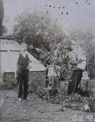 William Samuel, Dot Samuel, Mary Ellen Samuel and Billy Samuel in the garden behind the Market Street Store