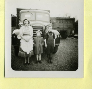 Kathleen Samuel with Catherine and John/Richard? standing in front of a new lorry