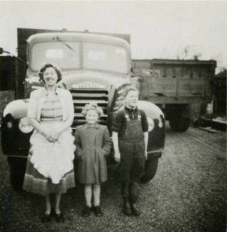 Kathleen Samuel with Catherine and John standing in front of a new lorry