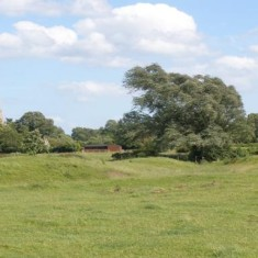Locality (10). Earthworks by the River Devon, marking the medieval grange farm at Muston.