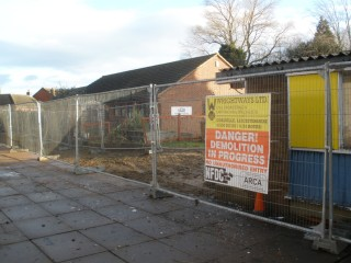 The demolition site, with the Play Group building in the background.
