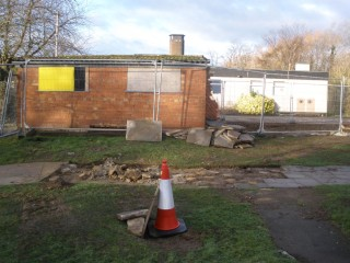 The remaining shed, with the Community Centre in the background.