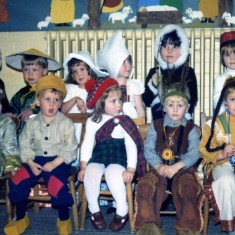 Children from 'around the world' visiting the stable at the Playgroup Christmas Concert in 1980
