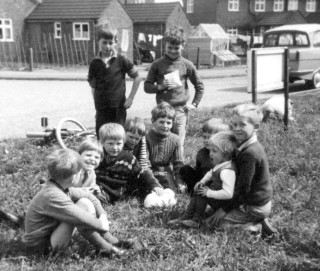 A picture taken in south Crescent near my grandmother's house not long before my cousins emigrated to Australia. Pictured here are; Godfrey Sutton and Neil Coddington (standing), with (sitting), left to right, Robert Bradshaw, Peter Wilson, myself, Sarah, Neil, & Sean Bradshaw, Donna and Chris Taylor.