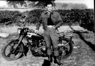 Dick Robinson as a dispatch rider, 1944, leaning on his motorbike. | Neil Fortey