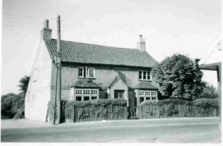 1950s photograph of what was known as 'The Rosary'  - with gas lighting to the left