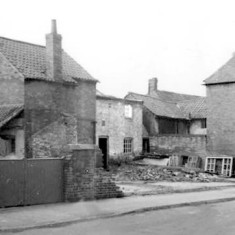 After demolition. The hairdresser's can by recognised by the dovecote.