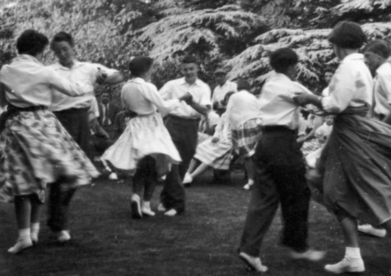Scouts and Guides dance on Bottesford Rectory lawn during a village fete in 1953.