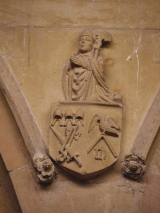 Above the eastern column of the S arcade of the nave: shield bearing the arms of the diocese of Llandaff and of the Marshal family, surmounted by a copy of the tomb effigy of Henry Marshal, Bishop of Exeter.