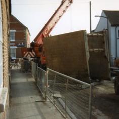 Lifting hydraulic shutters on High Street