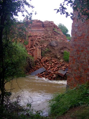 Sadly after the heavy rains of June 2007 the bridge collapsed when the bank of the stream was suddenly eroded. This may well have been the result of neglect of the bridge over the decades since the line closed in the 1960s.