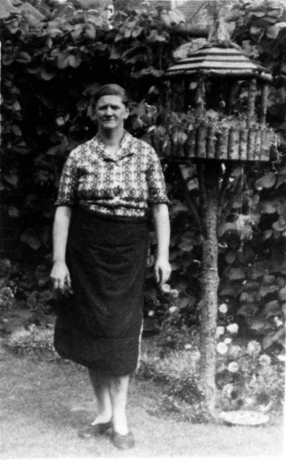 Mrs Vera Bradshaw, in the police station garden at Bottesford, 1950.