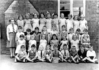 In the yard of the old school on Grantham Road.