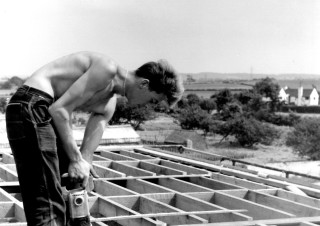 Neville Bagnall working on the building of the new schol