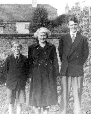 1952 in the Police Station back garden. The house in the background is Mr Tinkler's house in Chapel St, since demolished.
