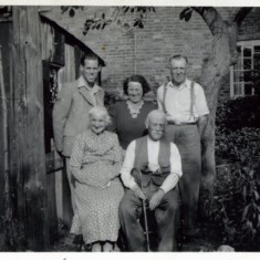 The Sutton Family in 1949 in the garden of No 11 High Street with Standley's Cottages in the background - Bill Jnr; Millie and Bill Snr with Eliza and Philip Sutton
