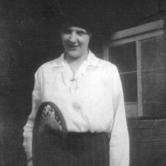 Winnie Bray playing tennis in the garden of the Bray's house in Muston.