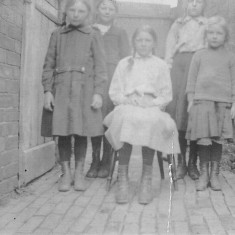 Winnie, Barbara, Susan, Annie and Clarice Bray just inside the gate to the right front side of the Bray's house on Main Street, Muston. C. 1910.