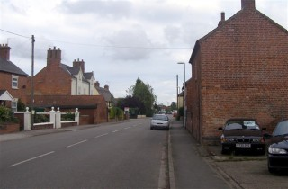 A contemporary  view of High Street from Woodhouse and Carman's garage.