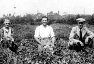 Ann Hargreaves,                          Frank Baggley,               Billy Evans,  The Nurseries Market Garden South Station House in the background.