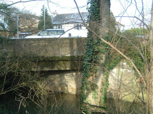 The final bridge at the east end of the village is a large concrete structure that straddles the old A52. This was built in the 1930s when the road was re-aligned. Before this date, the main road running east towards Muston and Grantham ran along what is now Rutland Lane, turned along Easthorpe Lane and crossed the river by the old Washdyke Bridge. On the northern side of the river it turned sharply to run eastwards parallel to the river.
