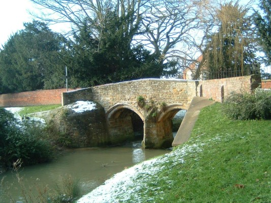 We now come to the Packhorse Bridge or Dr. Fleming's bridge, possibly the prettiest in the village. This was built in 1590 by Dr. Fleming, rector of Bottesford. One day, while trying to cross the river to church when the river was in flood, he had to be rescued. As a debt of gratitude he had the bridge built.