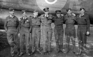 The crew in front of their Avro Lancaster aircraft K for Kitty - PO-K.  From the left  P/O John Lockwood (bomb aimer), P/O George Cribbin (navigator), F/O Keith Cazaly (mid gunner), F/L John Desmond RAAF (pilot), F/O Graham Joseph RAAF (wireless operator), Sgt Edward Davis (Teddy) (flight engineer), P/O John Ryalls RAAF (rear gunner)