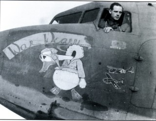 Captain Hugh J. Nevins, the 50th Troop Carrier Wing's glider officer, in the cockpit of his personal C-47 'War Weary'