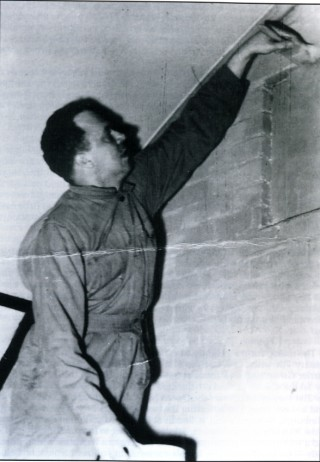 Lieutenant Joshua D. Logan of the 50th Troop Carrier Wing's A-2 Section (Intelligence), painting a room at Wing Headquarters. After the war Logan found fame as director of the film South Pacific and co-writer of the musical Paint Your Wagon