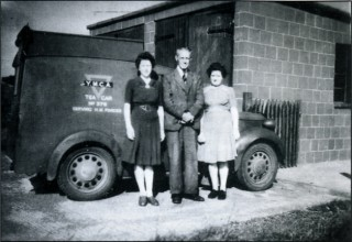 'Char and a Wad' - the all important Y.M.C.A. tea waggon and its civilian volunteer staff outside the garage on the Old Communal Site, 1945