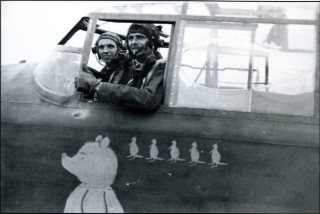 S/Ldr Keith Sinclair and his Flight Engineer Sgt Paddy Traynor in the cockpit of their usual aircraft 'Pregnant Winnie'