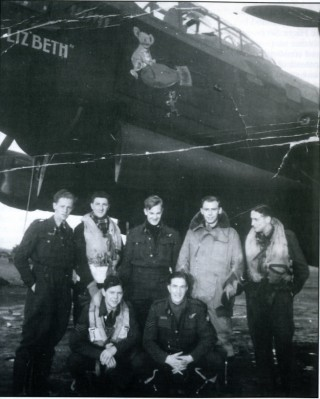 The crew of 'L-Liz'beth', Bottesford, Spring 1943. Standing, left to right: Sgt W.S. Buchanan, Sgt C.A. Chapman, Sgt J. Greenwood, Sgt W. Bruce, Sgt N.C. Smith. Front: Sgt P. Donlevy, Sgt A.E. Michaels