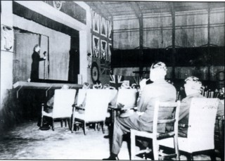 'On a wing and a prayer' - Gracie Fields gives a concert in one of Bottesford's hangars, 31st August 1943. Officers sit in chairs, 'erks' hand from the ceiling, and fourteen disgruntled crews are sent to attack Berlin!