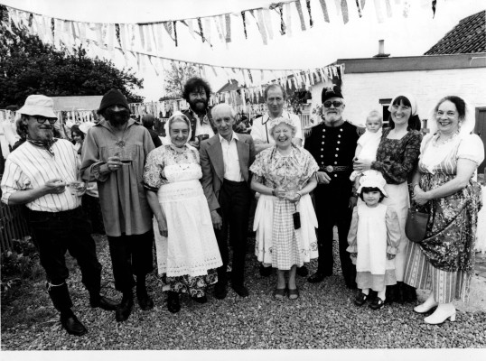 Residents celebrating in fancy dress at the rear of the Bunkers Hill Cottages, built in 1989. | Mr Vic Martin