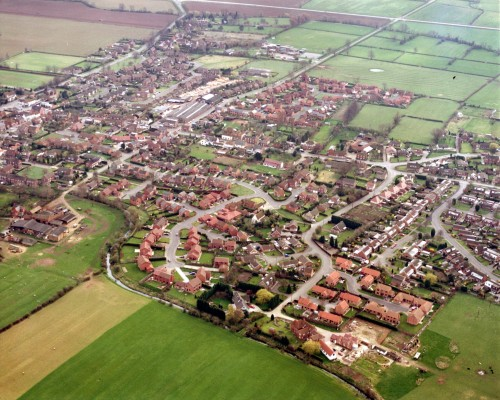 An aerial photograph looking down obliquely at the housing developments of the West End of Bottesford during the 1970s-1980s. | Contributed by Mrs Kathy Sarham