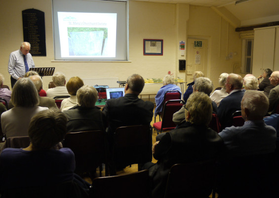 A typical meeting - here Malcolm Owen is talking about the recent GPS survey of the historic graveyard at St Mary's parish church. | Neil Fortey