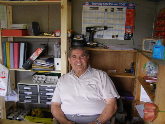 Mr Lol Pickin sitting in his office at the Orston Lane Nursery during an oral interview session in 2008. He is relaxed, smiling at the camera. | Taken by Neil Fortey, 2008