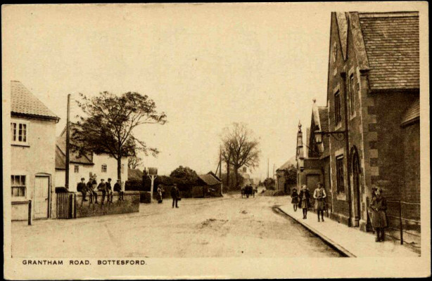 An old postcard of Grantham Road with the Red Lion on the left and the village school on the right | Terry Wing