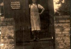 W.A. Wing, cobbler, at his workshop hut