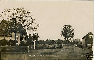 Grantham Road and the Red Lion - an early postcard - looking eastwards with the pub on the left of the view   Contributed by Mr Terry Wing