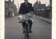 Arthur Wing, postman, on bike, Queen St