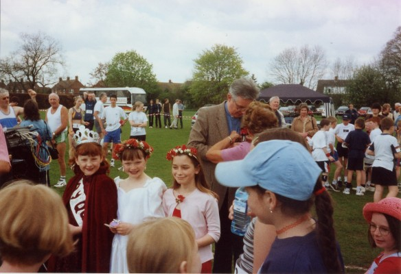 The May Queen and attendants at the fete on the playing field, Rev Geoffrey Spencer in background | Contributed by Mts Mary Taylor